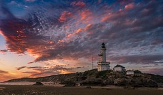 Goodnight to the Point (Goldmanoz) Tags: pointlonsdale pointlonsdalelighthouse bellarinepeninsula geelong beach lighthouse sea ocean rocks shore sunset twilight dusk sky clouds tide