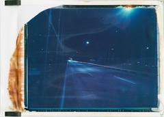 Bridge at night (Polaroid T669) (mmartinsson) Tags: 2018 night modelp bridge 75mm hackerbrücke tungsten film 669 analoguephotography expired mamiyasekor scan longexposure lighttrails cars epsonperfectionv700 polaroid mamiyauniversal instantfilm t669 münchen bayern tyskland de