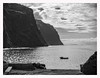 On The Bay Of Ribeira Brava (kurtwolf303) Tags: madeira ribeirabrava portugal water sky clouds ocean landscape seascape monochrome bw sw bay sea rocks coast küste cliff steilküste olympusem1 omd microfourthirds micro43 systemcamera mft kurtwolf303 boat boot silhouettes gegenlicht backlight contraluz