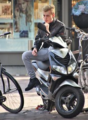 IMG_2605 (Skinny Guy Lover) Tags: outdoor guy man male dude blond sitting sit seated people scooter leatherjacket jeans greyjeans grayjeans smoker smoking manspreading portrait