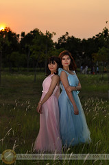 Sunset portrait (Hosting and Web Development) Tags: two people person portrait field costume couple young pink cyan sunlight summer sunshine sun evening body beautiful bride dress d90 smile stand shoulder sky hair happy hand grass vertical vietnam arm asia woman outdoor nikon eyes face femininity female flash