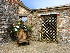 Courtyard Corner (Julie (thanks for 9 million views)) Tags: wall stone chair flowers window hww loftushall wexford ireland irish touristattraction iphonese 2018onephotoeachday