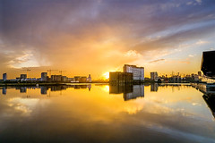 Sunset over Royal Victoria Docks (adrians_art) Tags: isleofdogs royalvictoiadocks docklands water reflections urban city london uk england sky clouds sunset outdoors buildings structures light dark yellow red gold blue