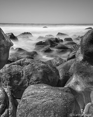 Mystery Of The Beyond (www.karltonhuberphotography.com) Tags: 2016 bw blackandwhite californiacoastline foregroundinterest karltonhuber lagunabeach longexposure misty monochrome mystery naturalworld nature ocean outdoors pacificocean rocks rockyshore rough rugged seascape seashore shorelinerocks silkywater socal southcounty southerncalifornia theoc uncertainty verticalimage watersedge