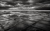 Tessellated pavement (pierre pihouee) Tags: australia badweather blackwhite landscape tasmania