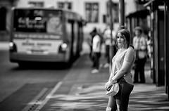 (graveur8x) Tags: woman waiting station bus candid street portrait mainz germany deutschland blackandwhite monochrome girl dof schwarzweis bw strase people female human outdoor outside contrast city bag frau shadow sun warm canon canonef135mmf2lusm canoneos5dmarkiv 5d f2 135mm urban