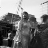 untitled (harrie bradshaw) (kaumpphoto) Tags: rolleiflex 120 tlr ilford bw black white drag queen street city urban crane backpack dress gown beard makeup shine sequins zipper silver gut man woman necklace scafold minneapolis