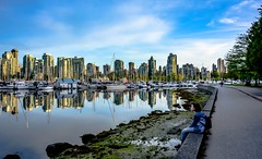 Reflect on life (Christie : Colour & Light Collection) Tags: sundown sunset vancouver coalharbour harbour marina sky clouds reflections reflecting reflective canada city park stanleyparkseawall peaceful calm serentiy boats yachts life wall pathway shore beach skyline worldclasscity cityofvancouver ponder skyscrapers evening seawall nautical outdoors masts