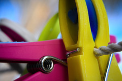 Plastic - [MacroMondays_20180423] (Arranion) Tags: plastic macro macromondays macromonday pegs washing line colours colors yellow pink canon eos 40d