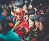 Bhutan: Atsara in their midst. (icarium82) Tags: bhutan canoneos5dmarkiv travel buddhist captureone festival gasafestival gasatshechu localpeople maskdance masked rural spectators traditionalclothing traditionaldress traditional tshechu vibrant canonef85mmf12liiusm sundaylights