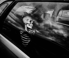 Backseat Driver (Cheryl Atkins) Tags: blackandwhite skeleton funny iphone street streetphotography