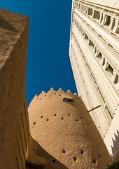 Al masmack palace and a modern building, Riyadh Province, Riyadh, Saudi Arabia (Eric Lafforgue) Tags: adobehouse ancient arabia arabianpeninsula architecture brick castle colourimage contrast fort fortified fortress gulfcountries historicsite ksa ksa9816 middleeast mudbrick nopeople palace riyadh saudiarabia tower traditional travel vertical watchtower riyadhprovince sa