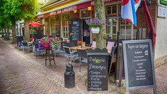 Langweer | Netherlans (Travis Daki) Tags: outdoors street snug town langweer bar café flag friesland holland tree