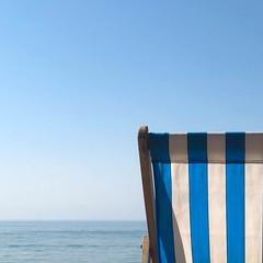 A place to rest (stevethesnapper) Tags: club weather 2018 fun stripes england calm peaceful may brighton bluesea deckchair brightonbeach still blueskies europe uk rest colours seascape bluesky