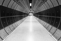 Footsteps Echo (Douguerreotype) Tags: london people monochrome subway blackandwhite uk underground urban british mono city tunnel britain tube metro bw gb england