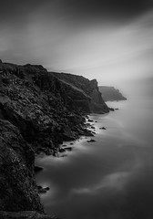 Dark Cliffs, Pentire Point (Mick Blakey) Tags: pentirepoint therumps black blackwhite cliffs clouds coast coastpath coastsurf coastal coastline contours contrast cornish cornwall dusk highlights light minimal monochrome moody peaceful rocks rocky scenic seascape serene shadows shoreline silhoette slowexposure solitary sunset tidal tranquil vista white