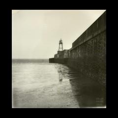 ____/=\#### (Polar Noire) Tags: polaroid sx70 wilhelmshaven marinemole lowersaxony allemagne instant pola lighthouse lowtide tidalflat dusk bnw blackandwhite integralfilm impossiblefilm coast coastline war marine