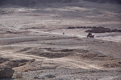 Driving in the Desert (meg21210) Tags: morocco desert sahara driving road roads truck motorcycle ouarzazate landscape barren isolated isolation sand dust