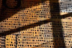 sapienza (Il cantore) Tags: parole words testo text parete muro wall ombra shadow marrone brown luce light sole sun roma rome stazionetiburtina 15challengeswinner