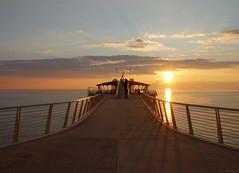 Pontile Bellavista Vittoria (Darea62) Tags: bridge seascape sunset architecture sky pier jetty tramonto versilia railing lidodicamaiore tuscany mediterranean bellavista vittoria sea panorama calm mare travel camaiore reflections toscana