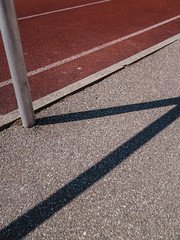 P2250016 (mkreibohm) Tags: runningtrack texture lines geometry parallels parallel diagonal concrete surface trackandfield athletics tartan track red minimal minimalism minimalist sports pole shadow