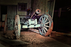 out of the past (Jen_Vee) Tags: barn storage cannon historic history wheels roll darkness shed wood iron blue artillery vignette shadows valleyforge knox vintage parks old antique forgotten rust decay weathered peeling howitzer hidden paint dust hdr