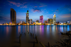 Ho Chi Minh City skyline and the Saigon River, Vietnam (Patrick Foto ;)) Tags: architecture asia asian background beautiful bitexco blue building buildings business chi city cityscape colorful culture district downtown dusk evening exterior famous ho hochiminh indochina landmark landscape light metropolis minh modern night office outdoor reflection river riverside saigon scene sky skyline skyscraper sunset tower travel twilight urban vietnam vietnamese view water hochiminhcity hồchíminh vn