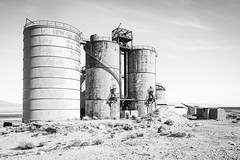 Inyo County, California (paccode) Tags: solemn california d850 forgotten landscape monochrome mojave silo factory abandoned blackwhite creepy quiet desert serious scary lonepine unitedstates us
