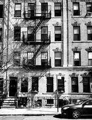 Bushwick Building Front (MassiveKontent) Tags: streetphotography bwphotography streetshot architecture geometric lines building bw contrast city monochrome urban blackandwhite streetphoto brooklyn bushwick nyc newyorkcity street fireescape newyorkstreet newyorkcitystreet newyork