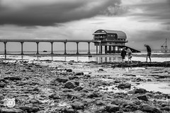 Playing in the rock pools at Bembridge (christian_lawrence) Tags: isle wight bembridge rock pools life boat station playing rockpool monochrome
