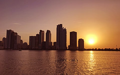 Buhaira Corniche (Irina.yaNeya) Tags: buhairacorniche sharjah uae emirates sunset sun sunlight water sea ocean waves architecture buildings sky skyline skyscraper iphone reflection urban city eau puestadelsol sol luz arquitectura agua mar olas edificio cielo ciudad reflejo الامارات الشارقة غروب الشمس ضوء ماء بحر أمواج فنمعماري بناء سماء برج مدينة шарджа оаэ эмираты закат солнце свет вода море волны архитектура небо отражение город