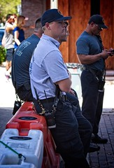 Security and blue caps (LarryJay99 ) Tags: 2018 lakeworthstreetpaintingfestibal urban festivals crowds florida people men male man guy guys dude dudes security aps blue manly virile studly stud masculine sexyman handsome barriers urbannomads urbanites profile face