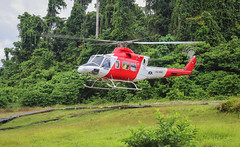 PNG B412 (Andy.Gocher) Tags: andygocher canon100d papuanewguinea herdbase bell b412 helicopter helicopters jungle