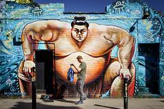Bag Check (ShrubMonkey (Julian Heritage)) Tags: london street mural art streetart urban graffiti bricklane wall colour sumowrestler guardianangel benjaycrossman candid people hanburystreet
