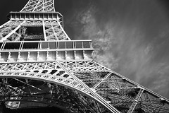 Well what the hell did you say? (.KiLTRo.) Tags: paris îledefrance france fr kiltro eiffel torre tower eiffeltower perspective architecture arquitectura structure estructura metal iron geometry lines curves sky clouds bw monochrome blackandwhite