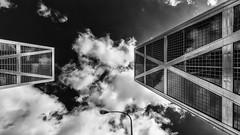 Puerta de Europa (Leipzig_trifft_Wien) Tags: madrid comunidaddemadrid spanien es building architecture twin towers torre skyscraper reflection sky two modern contemporary urban black white monochrome contrast grey mirror