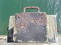 Pier map 5 (Nekoglyph) Tags: green sea water harbour pier wooden leg stump tar black map cracked whitby yorkshire lichens rust metal briefcase handbag handle