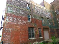 Ghost wall in Burlington, Iowa #1 (jimsawthat) Tags: smalltown burlington iowa downtown brick ghostsign vintagesign cocacola