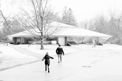 braving the snowstorm to get to the Butterfly exhibit - Dow Gardens (TAC.Photography) Tags: dowgardens butterflyexhibit midland winter snow cold snowing highkey monochrome bw blackandwhite 2018yip snowstorm runningchild tomclarknet tacphotography nikon nikoncamera