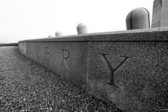 Portuguese Discovery Monument (iecharleton) Tags: flickrfriday lowangle portuguesediscoverymonument portuguese discovery navigation portugal newport rhodeisland monument carving carved stone letters words granite obelisk blackandwhite monochrome