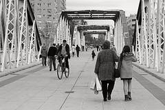 Bridge scene II (Fencejo) Tags: canon600dt3ikissx5 helios442258mm blackwhitebwstreetcityblackandwitestreetphotographymonochrome bridge zaragoza ebro river people