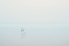 Lonely children chair in the fog (The Black Fury) Tags: monochrome sea white minimalist blanc seascape fog water nature light minimalism longexposure longuepose blue mer normandie beach