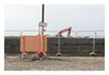 Orange (Number Johnny 5) Tags: tamron d750 2470mm decay telephone orange mundane beach imanoot construction new topographics space documenting nikon digger sign banal johnpettigrew fence