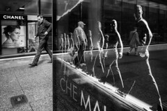 Stepping Out (johnjackson808) Tags: people busstop dance ad walking man streetphotography sidewalk monochrome reflection granvillest fujifilmxt1 poster chemalambo vancouver advertising blackandwhite bw downtown