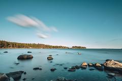 Moving Clouds (Bunaro) Tags: uutela aurinkolahti vuosaari finland suomi helsinki landscape waterscape sea ocean water rocks longexposure spring moving clouds clear sky turquise