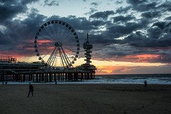 Scheveningen sunset (zilverbat.) Tags: seaside denhaag dutch pier noordzee travel thenetherlands timelife tripadvisor town clouds wolken ngc wallpaper postcard coastline zee strand zilverbat image wheel sunset rad holland netherlands nederland badplaats