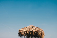 Straw umbrella on blue sky background. Summer. (wuestenigel) Tags: heat resort close color nature day beauty space straw holiday sea sun beach ocean umbrella sky sunlight isolated coast white sunshade relax vacation orange tourism background summer bright sand beautiful travel macro sunny tunisia object up blue yellow tropical relaxation