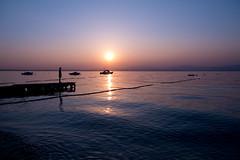 Sunset @ Lake Garda II (Marcel Cavelti) Tags: dscf7653bearb gardasee lake garda lazise lago lagodigarda sun sunset spring water boat ship