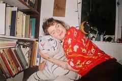 Ally and Sonny (Caroline Kutchka Folger) Tags: woman lady person friend portrait animal tiger flashphoto oakland downtownoakland indoors 35mm analog vintagecamera pointandshoot flashportrait kodakfilm