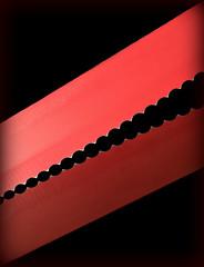 2018 Macro Monday: Jagged (dominotic) Tags: 2018 red jagged macromondays breadknife macro reflection blackbackground sundaylights explore sydney australia